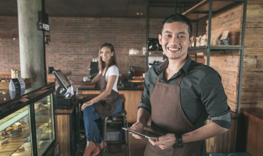 cafe owner using tablet pc